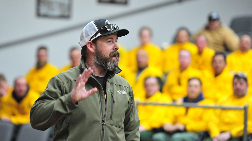 Instructor PJ Lingley talks to Arizona Wildfire & Incident Management Academy's 92 students in four S130/190 Basic Wildland Firefighting classes go out on their field day at Embry Riddle Aeronatical University, Wednesday, March 13, 2019, in Prescott. (Les Stukenberg/Courier)