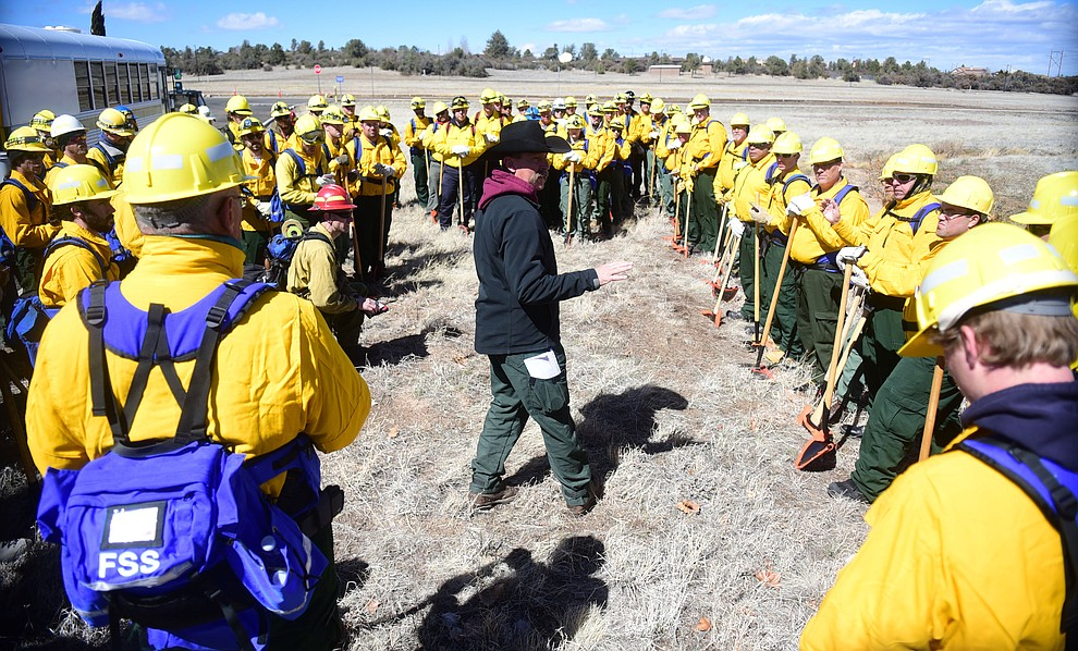 Todd Able gives a briefing to the Arizona Wildfire & Incident Management Academy's 92 students in four S130/190 Basic Wildland Firefighting classes go out on their field day at Embry Riddle Aeronatical University, Wednesday, March 13, 2019, in Prescott. (Les Stukenberg/Courier)