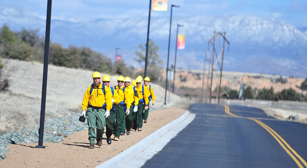 Arizona Wildfire & Incident Management Academy's 92 students in four S130/190 Basic Wildland Firefighting classes cut line while out on their field day at Embry Riddle Aeronatical University, Wednesday, March 13, 2019, in Prescott. (Les Stukenberg/Courier)