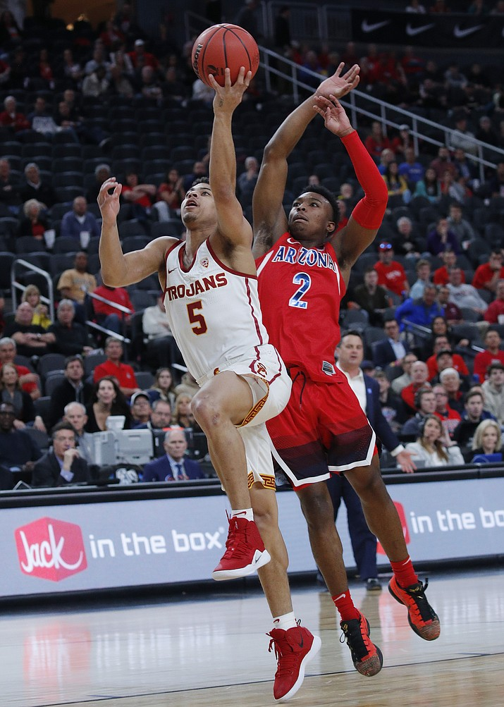 Southern California's Derryck Thornton (5) shoots ahead Arizona's Brandon Williams during the first half of an NCAA college basketball game in the first round of the Pac-12 conference tournament Wednesday, March 13, 2019, in Las Vegas. (John Locher/AP)