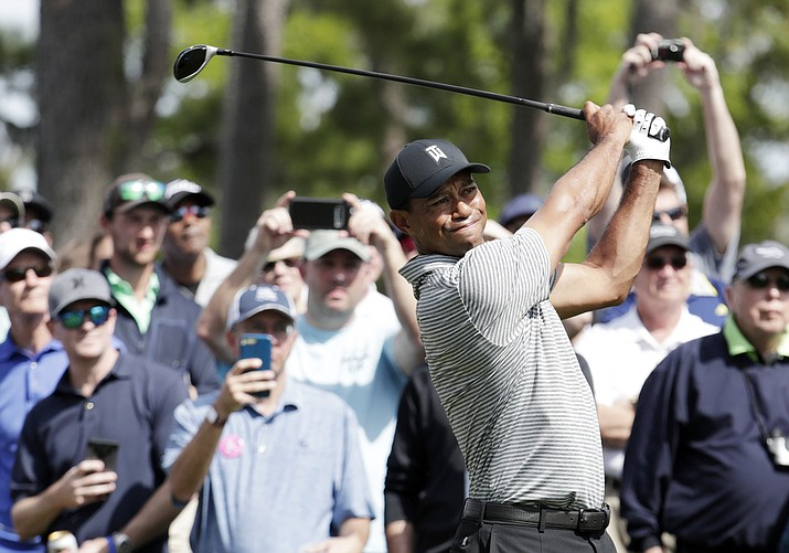 Tiger Woods hits from the seventh tee during a practice round at The Players Championship golf tournament, Wednesday, March 13, 2019, in Ponte Vedra Beach, Fla. (Lynne Sladky/AP)