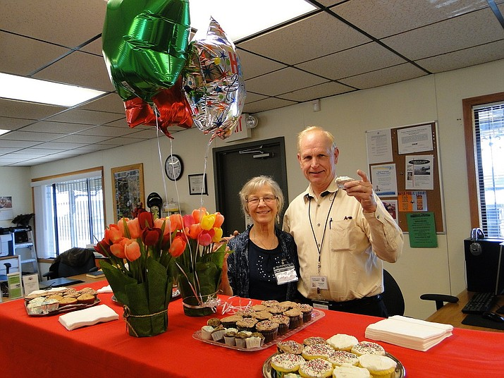 Virginia Tallent and Ted Johnson amid the tulips and cupcakes. (Courtesy)