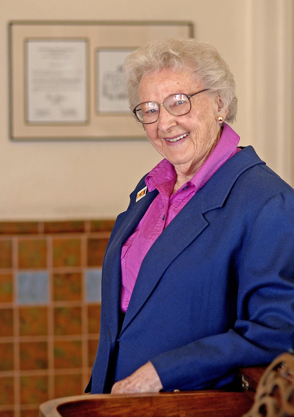 Elisabeth Ruffner, a longtime Prescott Historian is photographed at the Hassayampa Hotel Feb. 28, 2007.  A Governor's proclamation on the preservation of the Hassayampa Hotel, hangs behind Ruffner in which she was instrumental in saving. (Courier file photo).