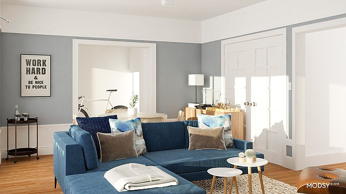 This photo rendering provided by Modsy shows a furnished room in a home done by the online design service. Modsy asks you to fill out a style quiz and provide a few pictures and measurements of the space you're looking to decorate. Then a designer does several possible plans complete with furniture options. (Modsy via AP)