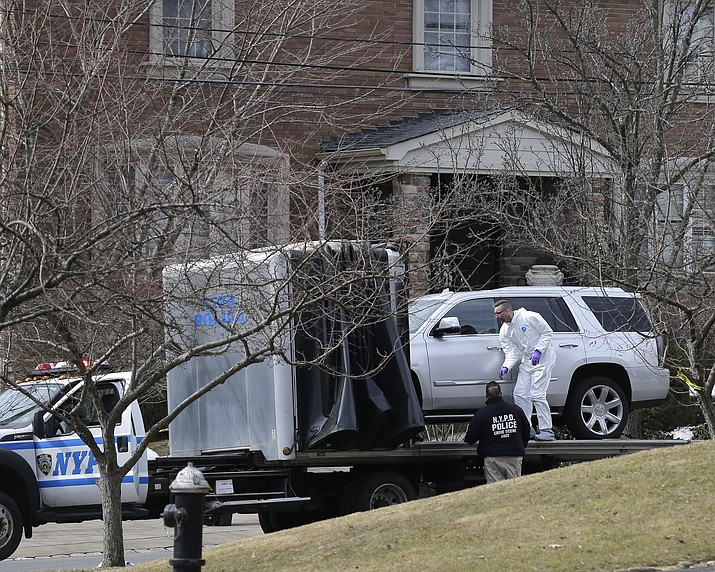 "Crime scene investigators load a car that appears to have been checked for fingerprints onto a flatbed truck in the Staten Island borough of New York, Thursday, March 14, 2019.  Francesco ""Franky Boy"" Cali was found with multiple gunshot wounds at his red-brick colonial-style house on Staten Island on Wednesday night and was pronounced dead at a hospital. (AP Photo/Seth Wenig)"