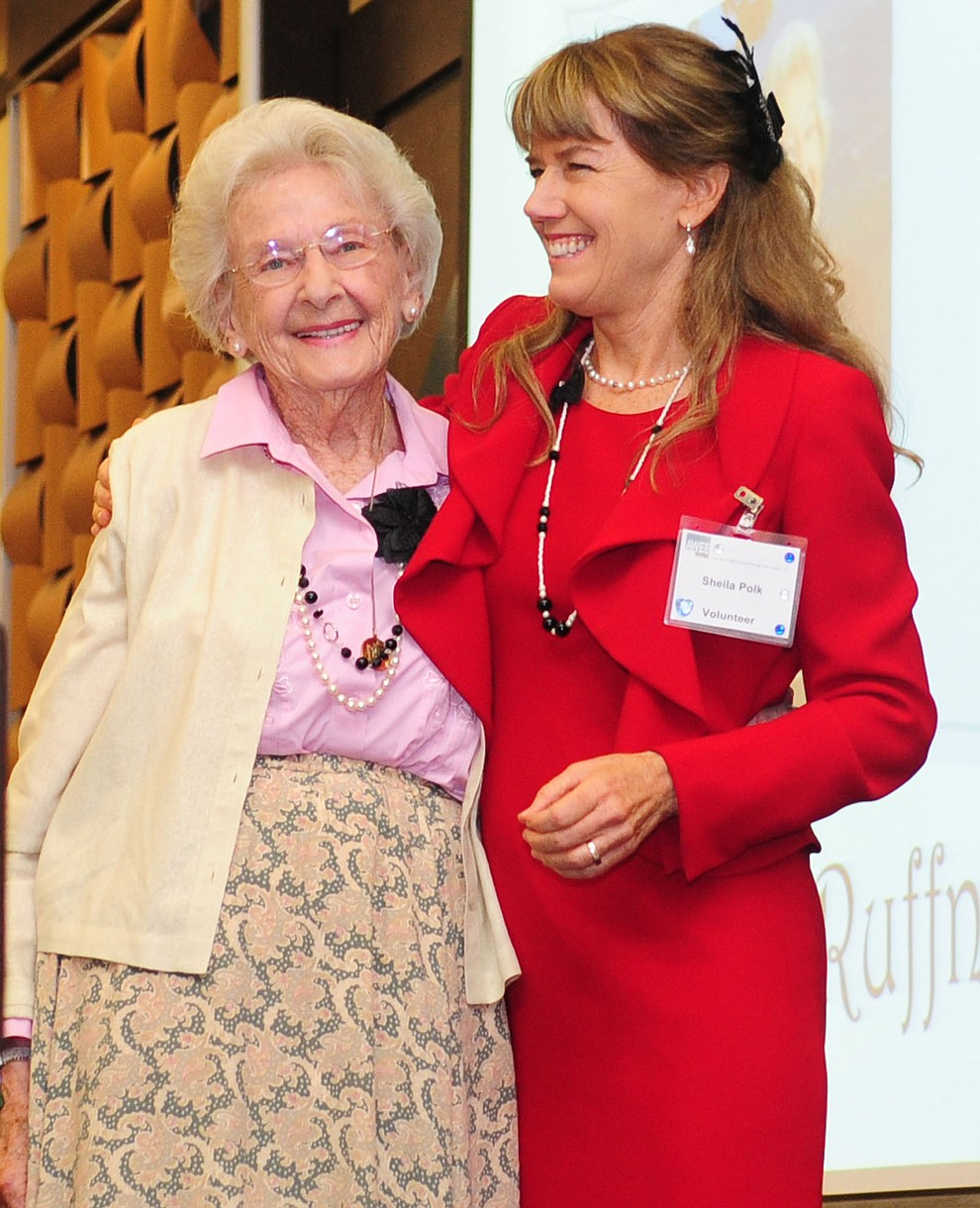 Sheila Polk, at right, congratulates Elisabeth Ruffner on her receiving the Barbara Polk Spirit of Volunteerism Award at AWEE's Annual Luncheon at the Prescott Resort Sept. 13, 2012. (Les Stukenberg/Courier file photo)