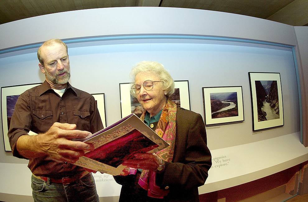 Photographer Gary Ladd, left  looks over his book of  photos with Elisabeth  Ruffner in this Nov. 2000 Courier file photo. Ruffner was an original founder  of Friends of Arizona Highways, which  now organizes photo workshops of The Grand Canyon. (Courier file photo)