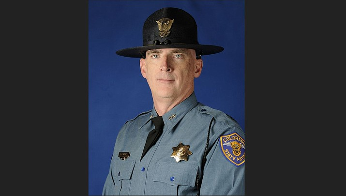 This undated photo provided by the Colorado State Patrol shows Cpl. Daniel Groves. The state patrol officer was hit and killed by a car as he was helping another driver who had slid off of Interstate 76 northeast of Denver. A window-rattling late winter storm brought blizzards, floods and a tornado across more than 25 states Wednesday, March 13 , 2019, stretching from the northern Rocky Mountains to Texas and beyond. (Colorado State Patrol photo)