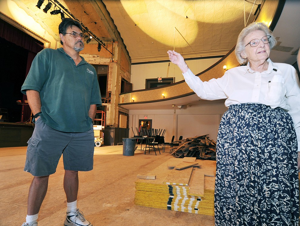Haley Construction project manager Lee Vega listens as Elisabeth Ruffner explains some of the intricate historical facts of the Elks Opera House July 29, 2009 as demolition and reconstruction begins and will continue over the next 9 months. (Les Stukenberg/Courier file photo)