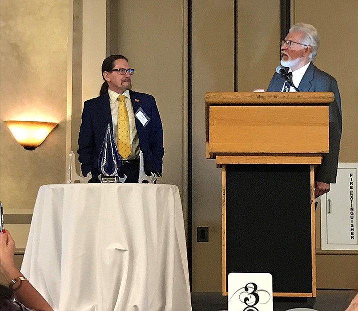 Jonathan Conant, left, received the Sue Gilbertson Leadership Award from Mentally Ill Kids In Distress for his tireless dedication and assistance to the children of the state who are involved in dependency matters. 