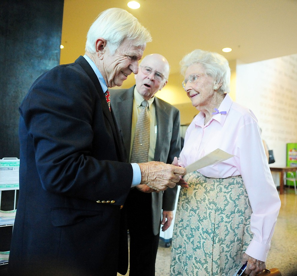Arizona State University President-Emeritus Lattie Coor, at left, shares a laugh with Tom Benson and Elisabeth Ruffner before he gives his presentation on ÒThe Arizona We WantÓ at Yavapai College in Prescott July 30, 2014. Approximately 70 people attended the speech and question and answer session afterward. (Les Stukenberg/Courier file photo)