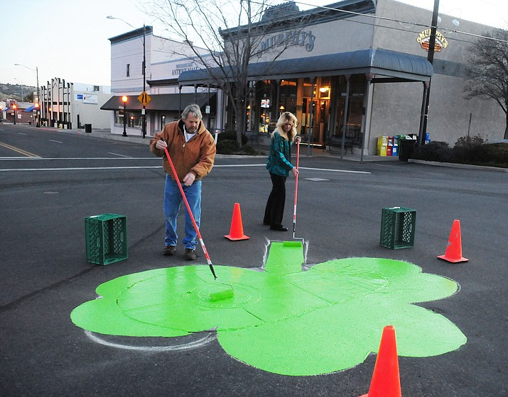 Wendy Price and Clint Manchester paint the shamrock in honor of St. Patricks Day in front of Murphy's Restaurant at the intersection of Cortez and Willis Streets in Prescott early Friday, March 13 morning.