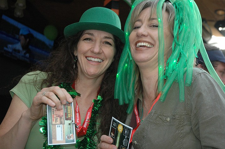 Tracy Himes, left, and Kachina Kelly, right, were participating in the Whiskey Row Pub Crawl for the first time. (Jason Wheeler/Courier, file photo)