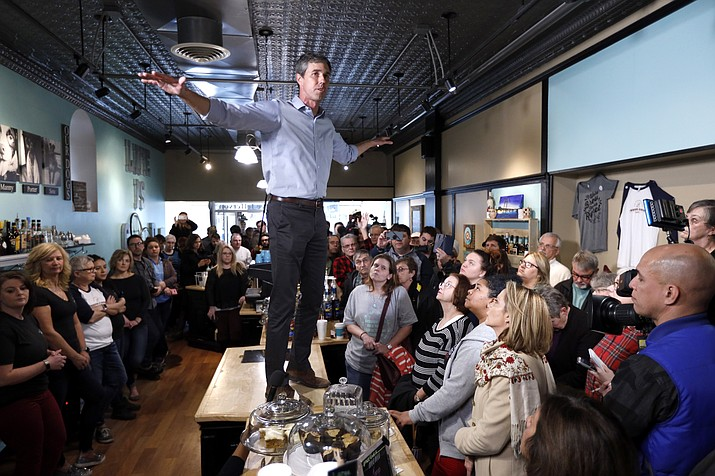 Former Texas congressman Beto O'Rourke speaks to local residents during a meet and greet at the Beancounter Coffeehouse & Drinkery, Thursday, March 14, 2019, in Burlington, Iowa. O'Rourke announced Thursday that he'll seek the 2020 Democratic presidential nomination. (Charlie Neibergall/AP)