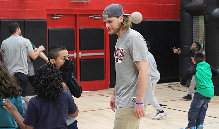 Arizona Diamondbacks pitcher Matt Koch, here interacting with kids at an Arizona Boys and Girls Club, has a child of his own now. (Photo by Tyler Drake/ Cronkite News)