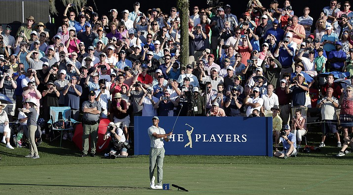 The gallery watches Tiger Woods tee off on the 17th hole during the first round of The Players Championship golf tournament Thursday, March 14, 2019, in Ponte Vedra Beach, Fla. (Lynne Sladky/AP)