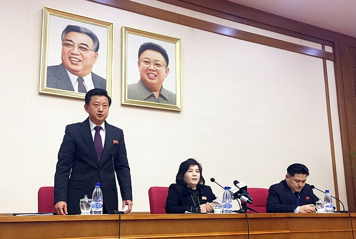 North Korean Vice Foreign Minister Choe Son Hui, center, speaks at a gathering for diplomats in Pyongyang, North Korea on Friday, March 15, 2019. North Korean leader Kim Jong Un will soon make a decision on whether to continue diplomatic talks and maintain the country's moratorium on missile launches and nuclear tests, the senior North Korean official said, noting the U.S. threw away a golden opportunity at the recent summit between their leaders. Interpreter is on Choe's right and the man standing is unidentified vice director of foreign ministry's North America desk. (AP Photo/Eric Talmadge)