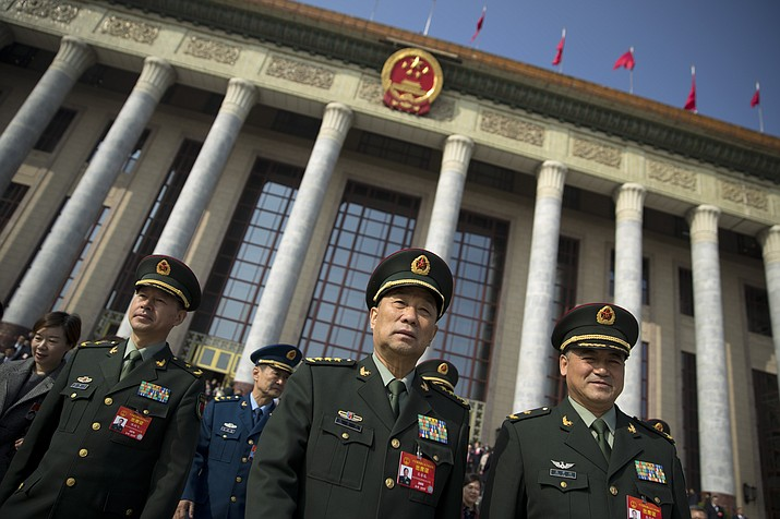 """Military delegates leave after a meeting one day before the opening session of China's National People's Congress (NPC) March 4, 2019, at the Great Hall of the People in Beijing. To a remarkable degree, the Pentagon's new budget proposal is shaped by national security threats that Acting Defense Secretary Patrick Shanahan has summarized in three words: """"China, China, China."""" (Mark Schiefelbein/AP, file)"""