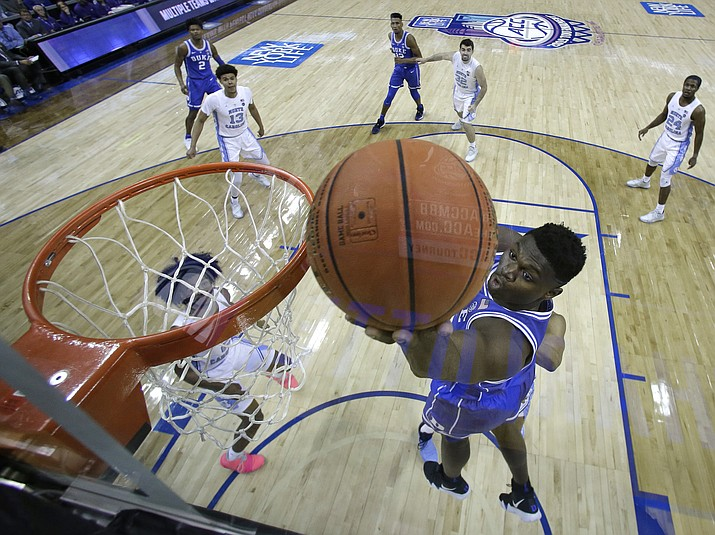 Duke's Zion Williamson drives to the basket against North Carolina during the second half of an NCAA college basketball game in the Atlantic Coast Conference tournament in Charlotte, N.C., Saturday, March 16, 2019. (Chuck Burton/AP)