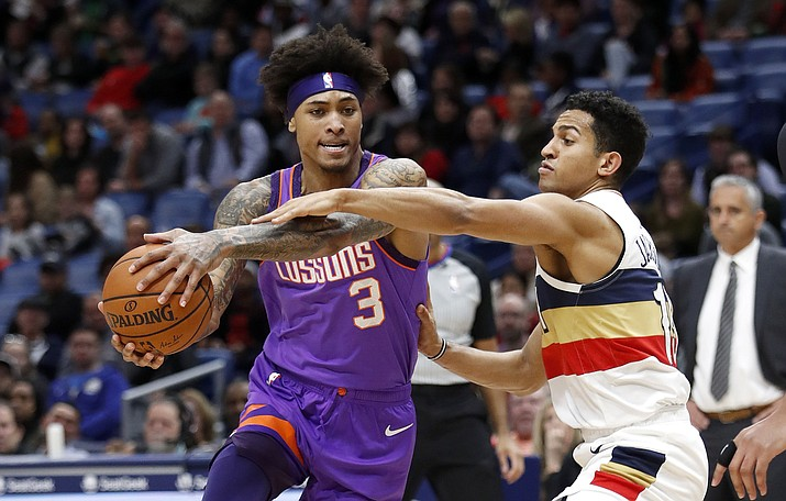 Phoenix Suns forward Kelly Oubre Jr. drives past New Orleans Pelicans guard Frank Jackson during the first half in New Orleans, Saturday, March 16, 2019. (AP Photo/Tyler Kaufman/AP)