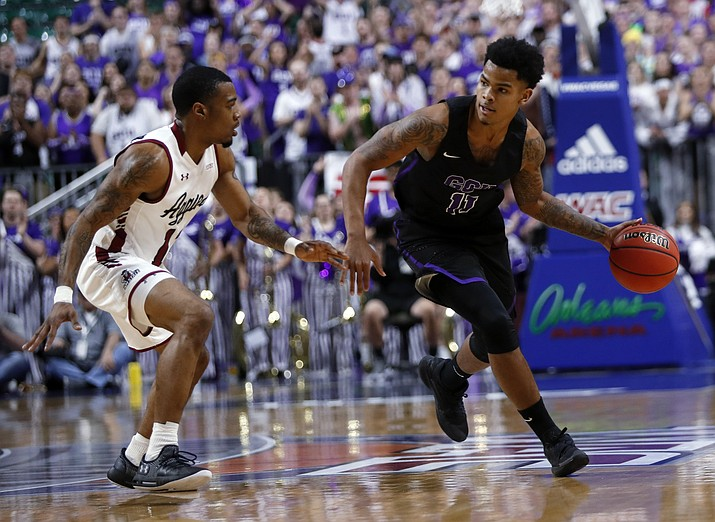 Grand Canyon's Damari Mislead drives by New Mexico State guard AJ Harris during the first half of the Western Athletic Conference men's tournament championship Saturday, March 16, 2019, in Las Vegas. (Steve Marcus/AP)