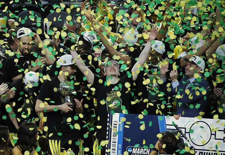 Oregon celebrates after defeating Washington 68-48 in an NCAA college basketball game in the final of the Pac-12 men's tournament Saturday, March 16, 2019, in Las Vegas. (John Locher/AP)