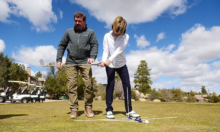 Inventor Ken Christopherson and golfer Judith Hinds demonstrate the Acculine Golf Pucks system at Capital Canyon Golf Club on Thursday, March 14, 2019, in Prescott. (Les Stukenberg/Courier)