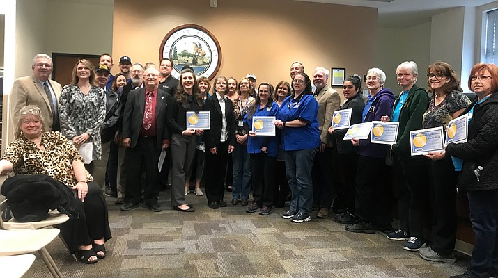 Winners of the Golden Plate Award stand with the Yavapai County Board of Supervisors at the BOS meeting on March 6. (Courier/ George Johnston)