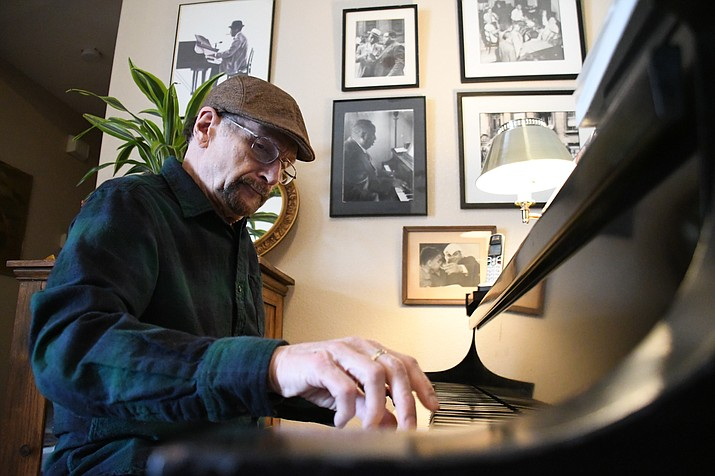 Mike Lipskin plays a few stride jazz songs on the grand piano at his home. Lipskin will be performing with Dinah Lee, a traditional jazz vocalist, 7 – 8:30 p.m. Saturday, March 23 at The Gallery at Kingman Center for the Arts, 208 E. Beale St. (Photo by Vanessa Espinoza/Daily Miner)