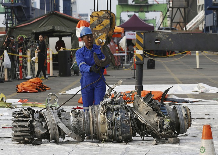 Officials move an engine recovered from the crashed Lion Air jet for further investigation Nov. 4, 2018, in Jakarta, Indonesia. The new Boeing 737 MAX 8 jet plunged into the Java Sea just minutes after takeoff from Jakarta early on Oct. 29, killing all of its passengers on board. (Achmad Ibrahim/AP, File)