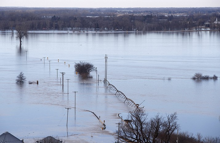 Looking southwest towards Waterloo Neb., high waters from the Elkhorn river cover Maple street in the distance Saturday March 16, 2019. The flooding followed days of snow and rain — record-setting, in some places — that swept through the West and Midwest. (Jeff Bundy/Omaha World-Herald via AP)
