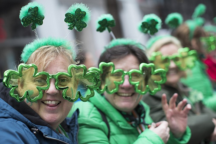 Sharon Keely, left, of Dublin, watches as participants march up Fifth Avenue during the St. Patrick's Day Parade, Saturday, March 16, 2019, in New York. (Mary Altaffer/AP)