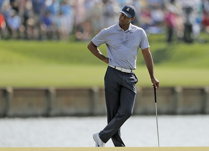 Tiger Woods reacts to hitting his drive into the water on the 17th hole during the second round of The Players Championship golf tournament Friday, March 15, 2019, in Ponte Vedra Beach, Fla. (Gerald Herbert/AP)