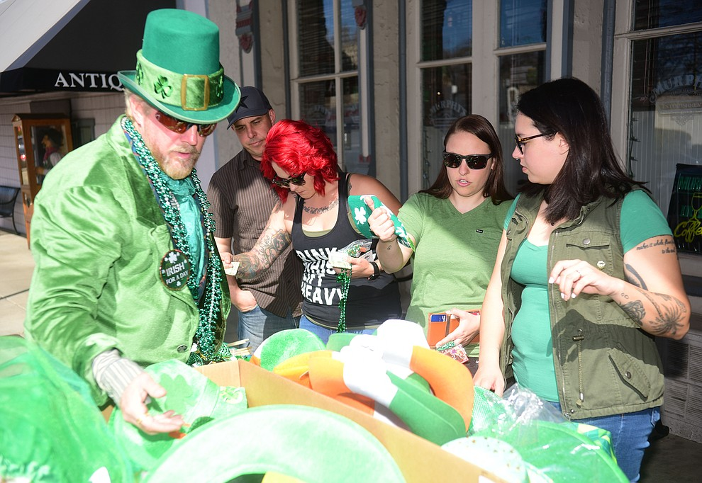 People grab last minute Irish merchandise during the 2019 St. Patrick's Day Pub Crawl Sunday, March 17, 2019 in downtown Prescott. (Les Stukenberg/Courier)
