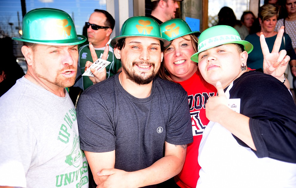 Brian Kelley, Aaron Sano, Michele Jurado and Sarah Reyes start their 2019 St. Patrick's Day Pub Crawl Sunday, March 17, 2019 in downtown Prescott. (Les Stukenberg/Courier)