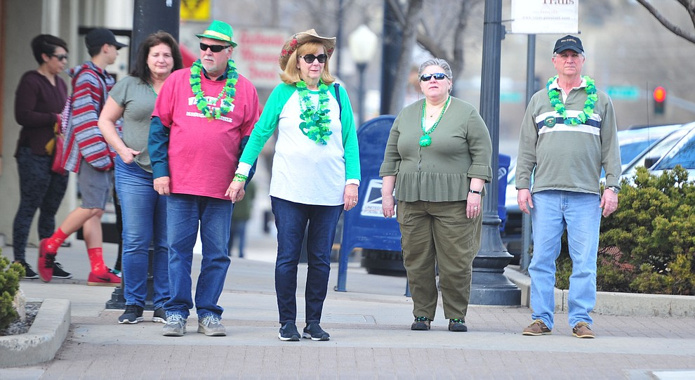 People wait to cross the street during the 2019 St. Patrick's Day Pub Crawl Sunday, March 17, 2019 in downtown Prescott. (Les Stukenberg/Courier)