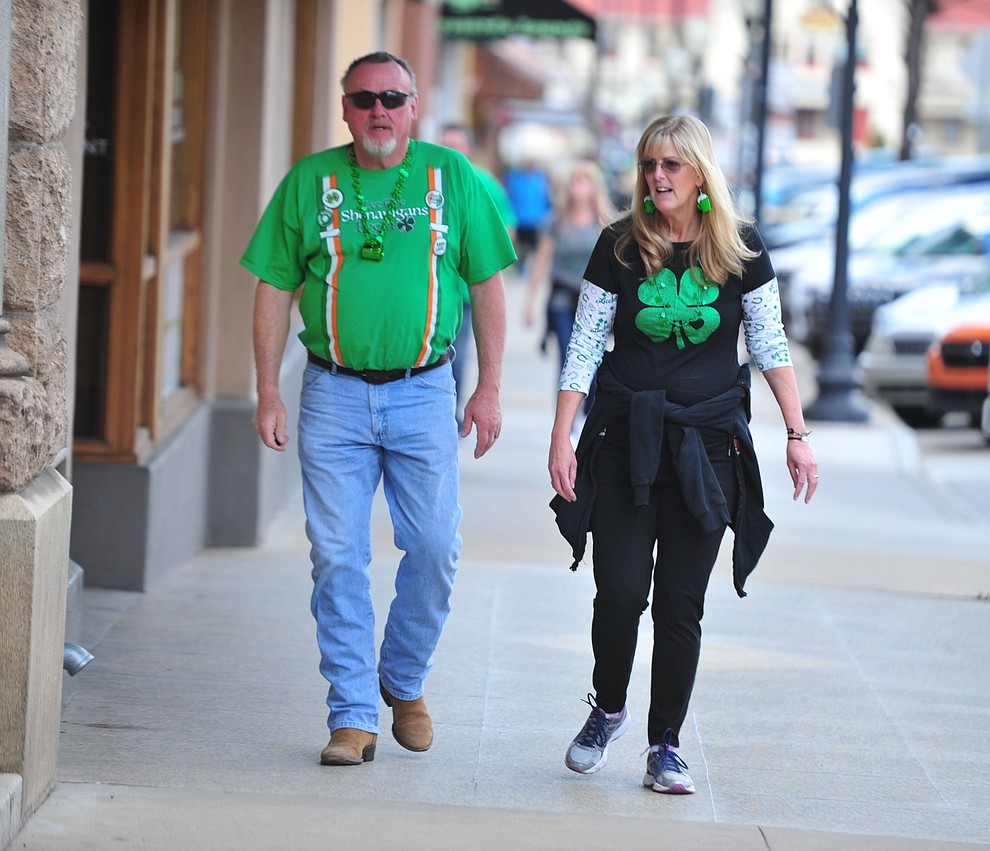 Mike and Bridget Kelley head to their next stop during the 2019 St. Patrick's Day Pub Crawl Sunday, March 17, 2019 in downtown Prescott. (Les Stukenberg/Courier)