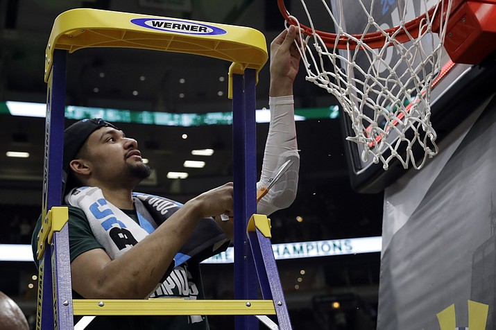 Michigan State's Kenny Goins cuts a piece of the net after defeating Michigan 65-60 in an NCAA college basketball championship game in the Big Ten Conference tournament, Sunday, March 17, 2019, in Chicago. (Nam Y. Huh/AP)