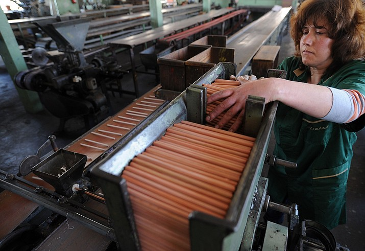 A worker seen at VIARCO's pencil factory in S. Joao da Madeira, Portugal, Friday, Feb. 24, 2012.  (Paulo Duarte/AP, File)