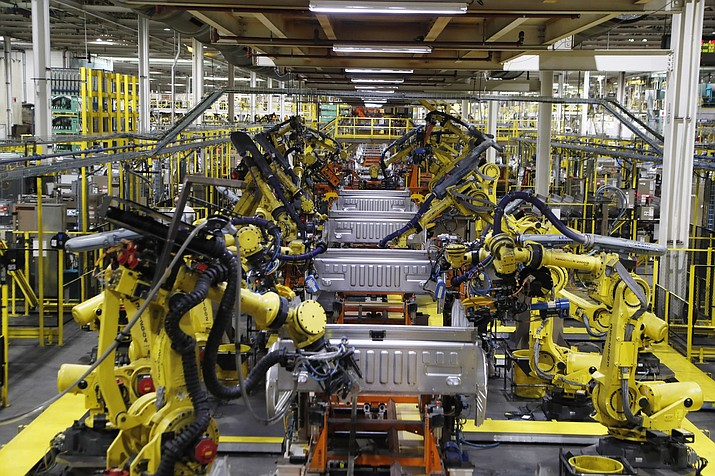 Robots weld the bed of a Ford F Series trucks on the assembly line at the Ford Rouge assembly plant Sept. 27, 2018, in Dearborn, Mich. (Carlos Osorio/AP, File)