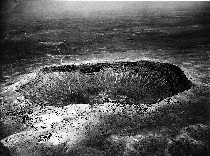 An undated photo of the mile-wide meteor crater near Winslow, Arizona. The crater was made 500 centuries ago when a 10,000,000-ton meteor impact dislodged 300,000,000 tons of rock. The 600-foot deep crater is 3 miles in circumference. (AP photo)
