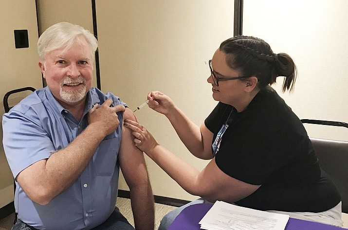 County Supervisor Chairman Randy Garrison getting his annual influenza immunization. (Yavapai County Community Health Services/Courtesy)