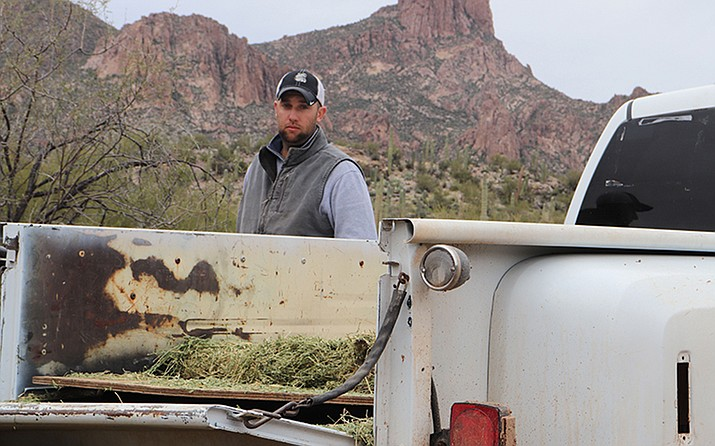 Jordan Selchow manages Quarter Circle U Ranch in the Superstition Mountains.(Photo by Lurissa Carbajal/Cronkite News)