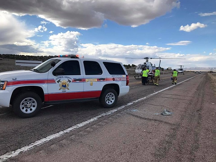 Two helicopters touch down on Highway 89 to transport two seriously injured people to Flagstaff Medical Center following a major vehicle crash late Monday afternoon, March 18. (Central Arizona Fire and Medical Authority/Courtesy)