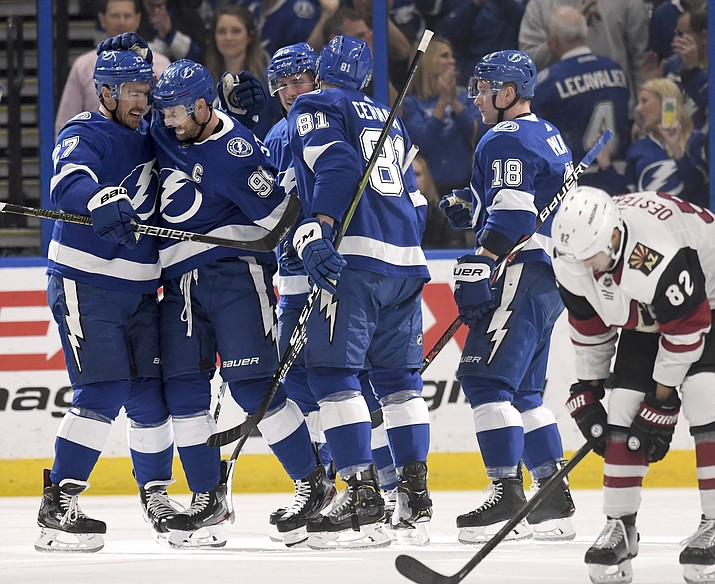 Tampa Bay Lightning defenseman Ryan McDonagh (27), center Steven Stamkos (91), defenseman Erik Cernak (81) and left wing Ondrej Palat (18) celebrate Stamkos' goal during the first period of an NHL hockey game against the Arizona Coyotes Monday, March 18, 2019, in Tampa, Fla. (Jason Behnken/AP)