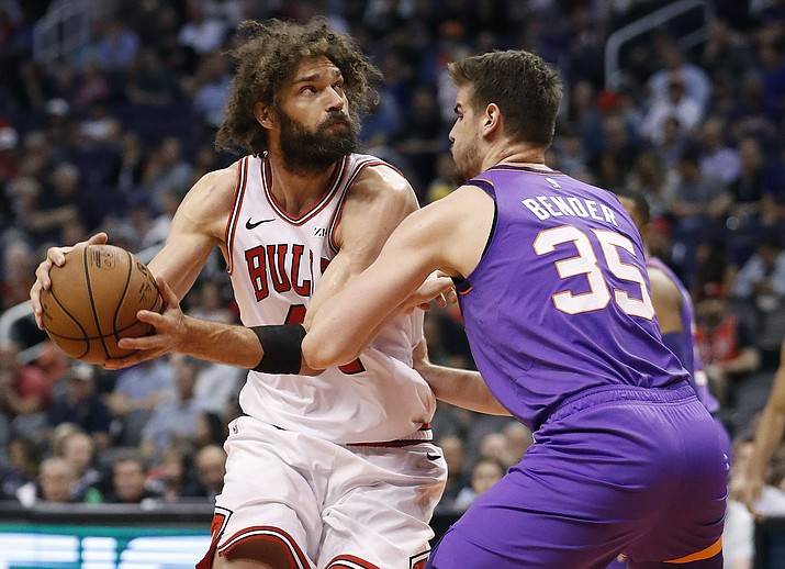 Chicago Bulls center Robin Lopez looks to shoot over Phoenix Suns forward Dragan Bender (35) during the second half of an NBA basketball game, Monday, March 18, 2019, in Phoenix. (Matt York/AP)