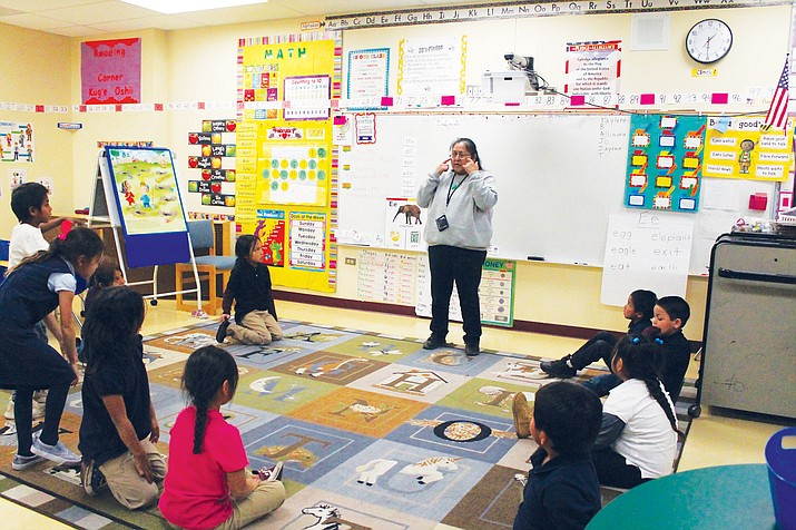 Marsha Goseyun, the first Apache language and culture teacher at the Apache Immersion kindergarten class, teaches students the Apache language during one of her classes Feb. 19 at Rice Elementary School in San Carlos, Arizona. (Joshua L. Butler/NHO)