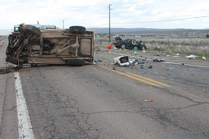 Two heavily-damaged vehicles rest along Highway 89 with debris scattered everywhere after they apparently crashed head-on Monday afternoon, March 18.