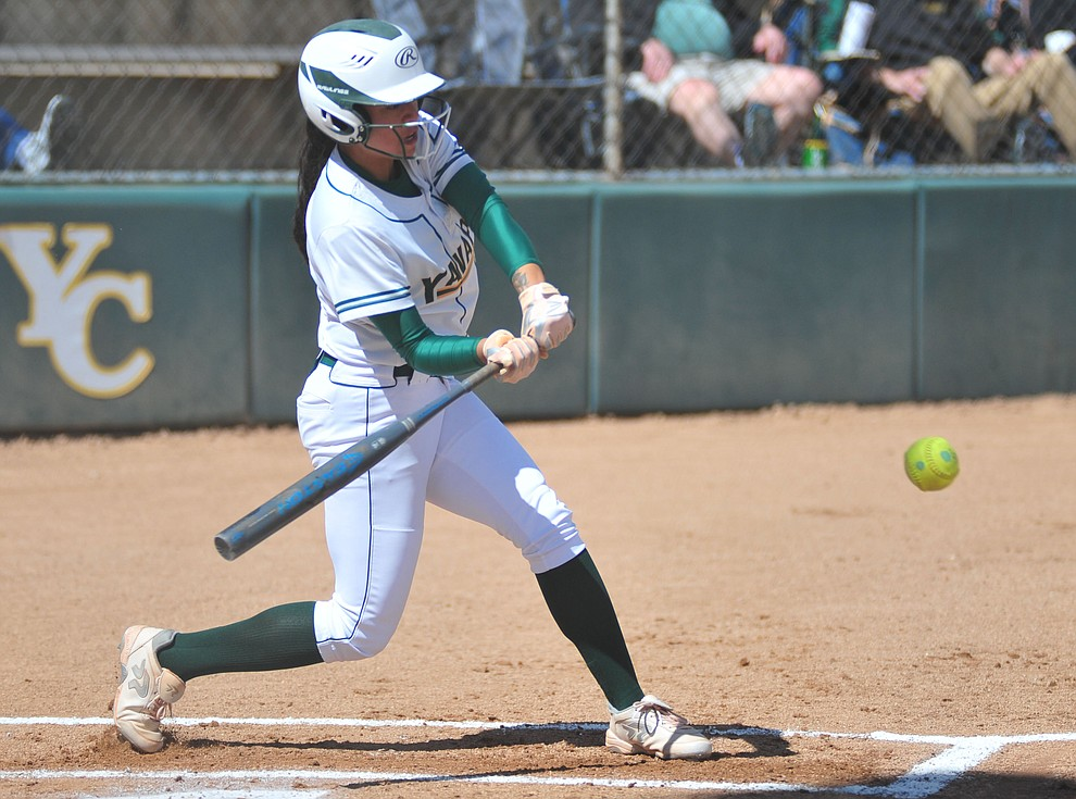 Yavapai's Neenah Pangilinan strokes a single as the Roughriders take on the Chandler Gilbert Coyotes Tuesday, March 19, 2018 in Prescott.