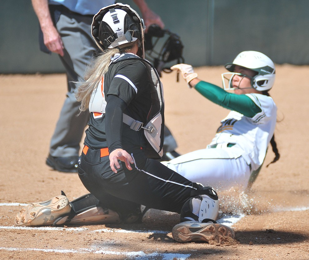 Yavapai's Neenah Pangilinan gets tagged out at home as the Roughriders take on the Chandler Gilbert Coyotes Tuesday, March 19, 2018 in Prescott.